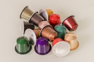 A variety of Nespresso Capsules in a pile