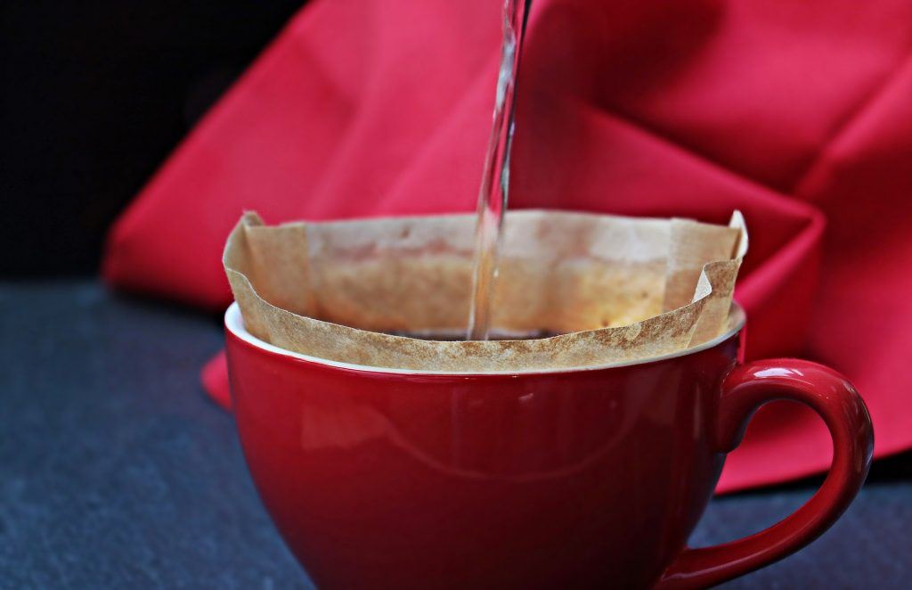 Pour Over Coffee in a red mug with a paper filter