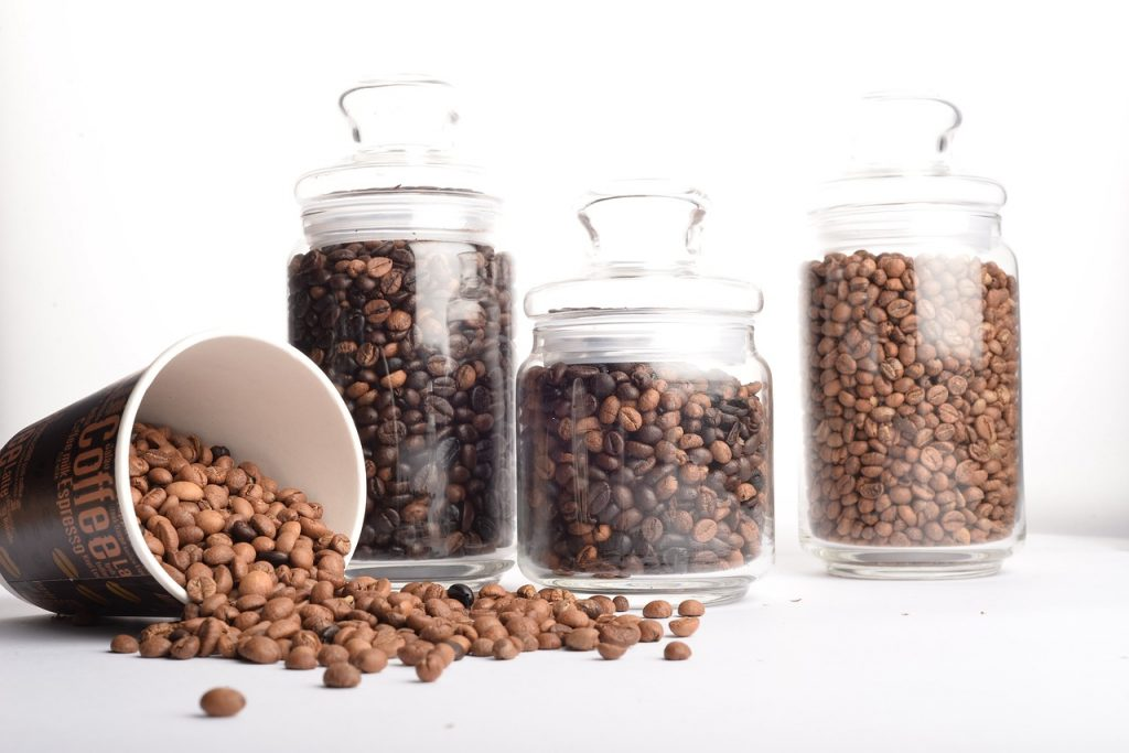 Dark Medium and Light Roast Coffee Beans in Glass Canisters