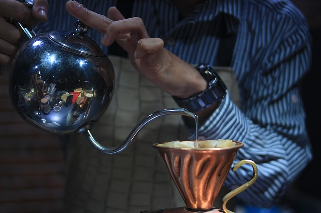 Pour Over Coffee Being Made With Water Pouring From Gooseneck Kettle