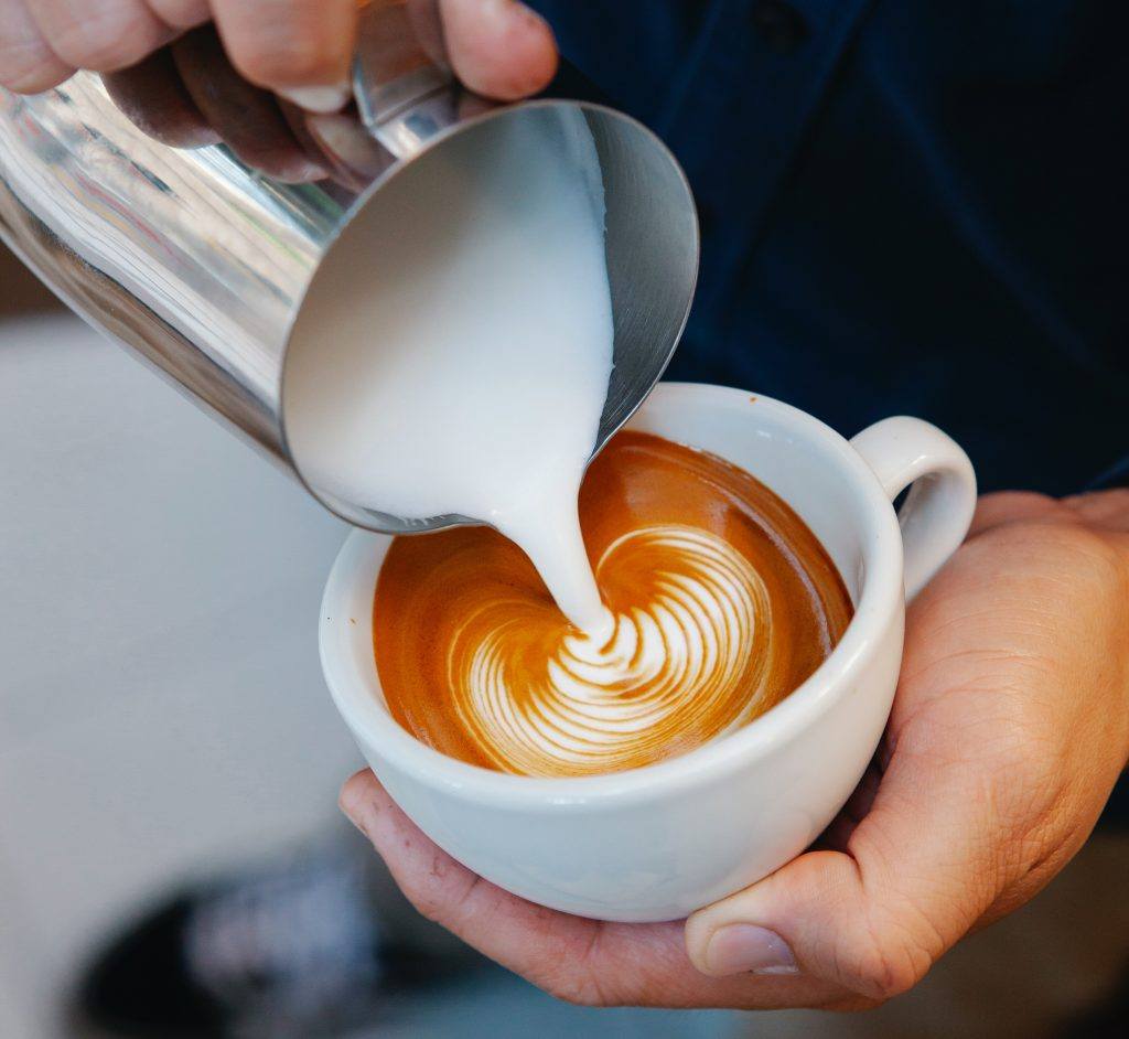 Steam Milk Pouring To Form Latte Art